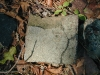 Brick fragment with partial imprint
