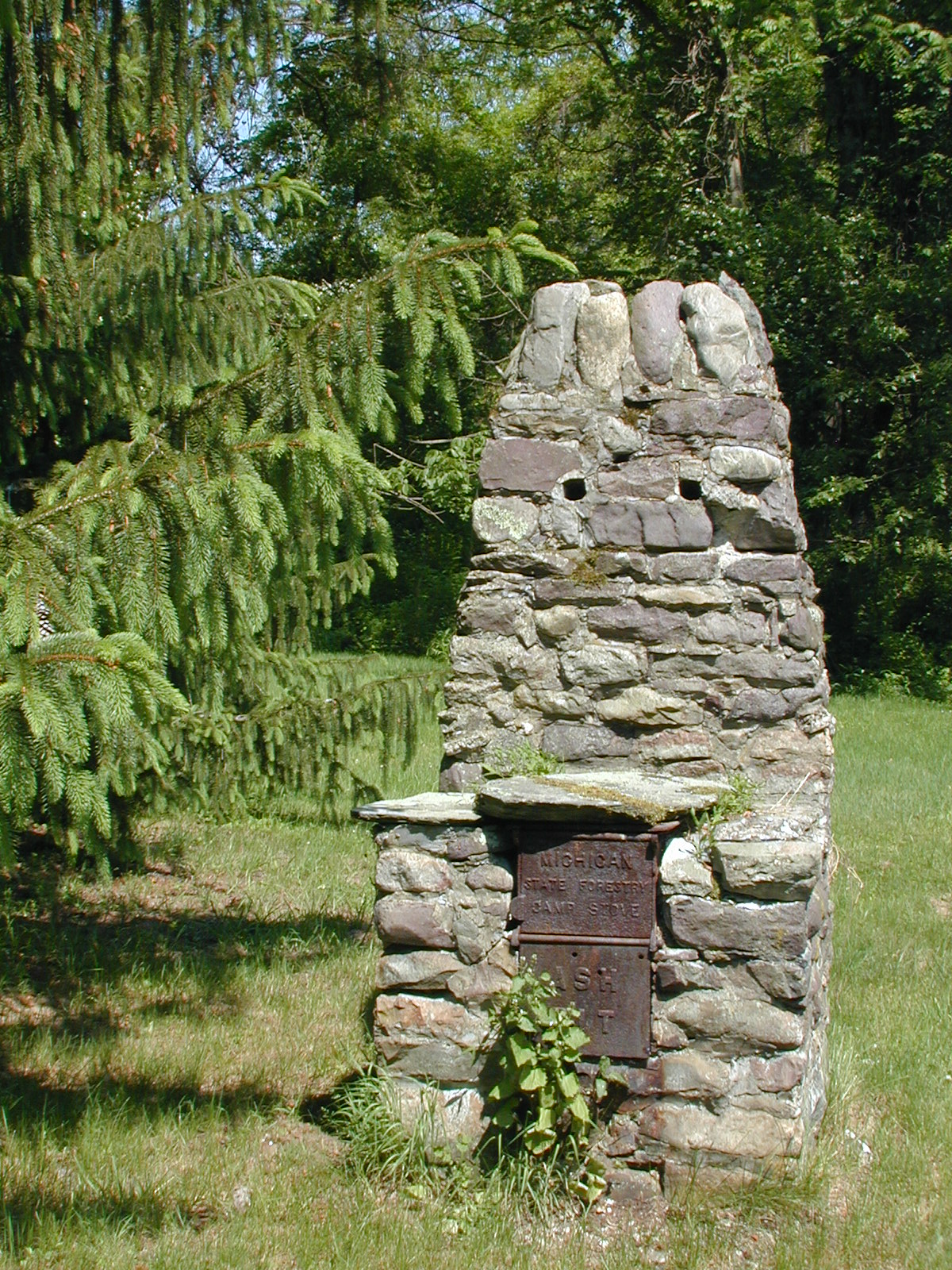 Ribble house, Michigan Forestry stove in back yard