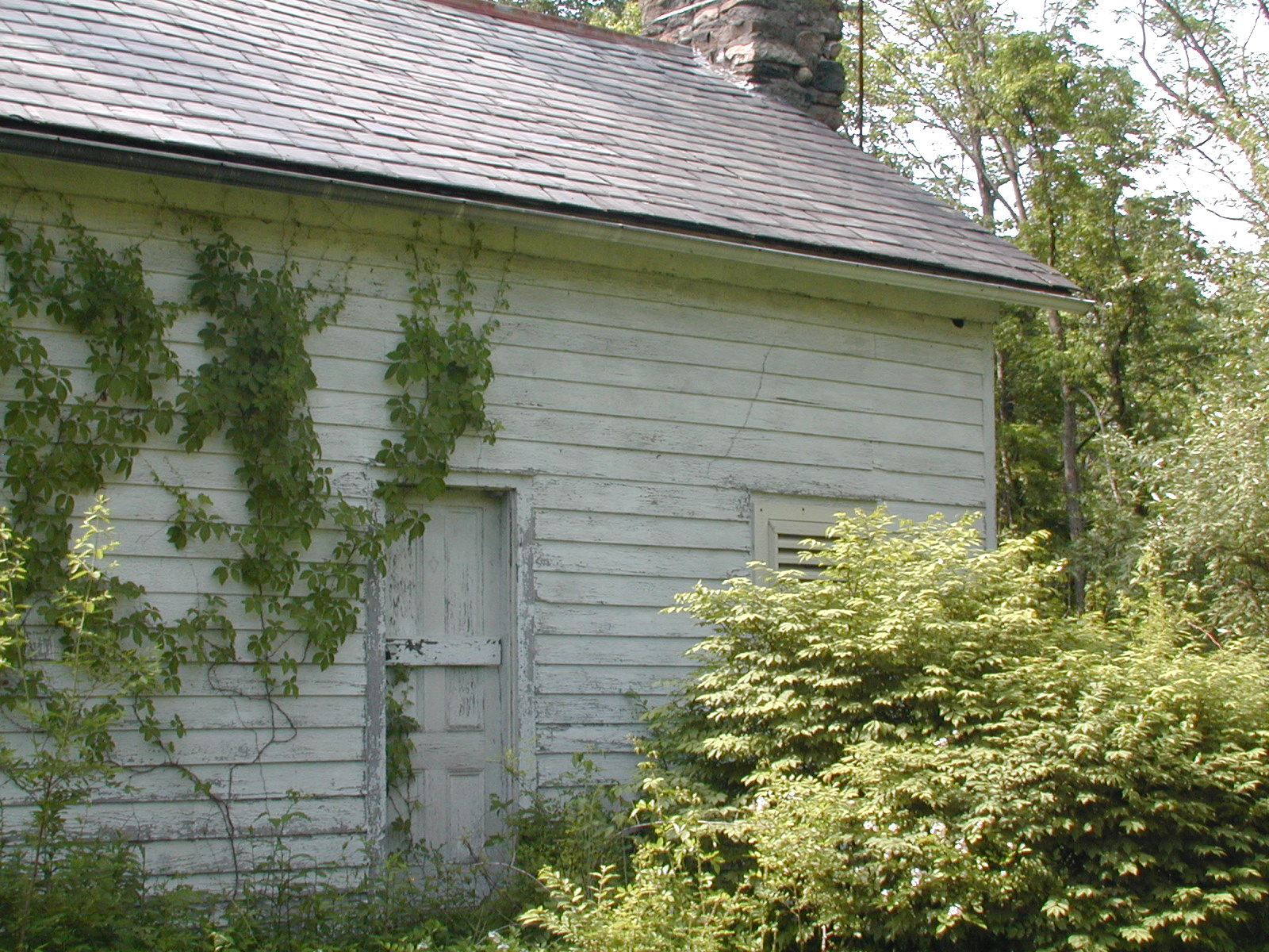 Second unknown house, side door