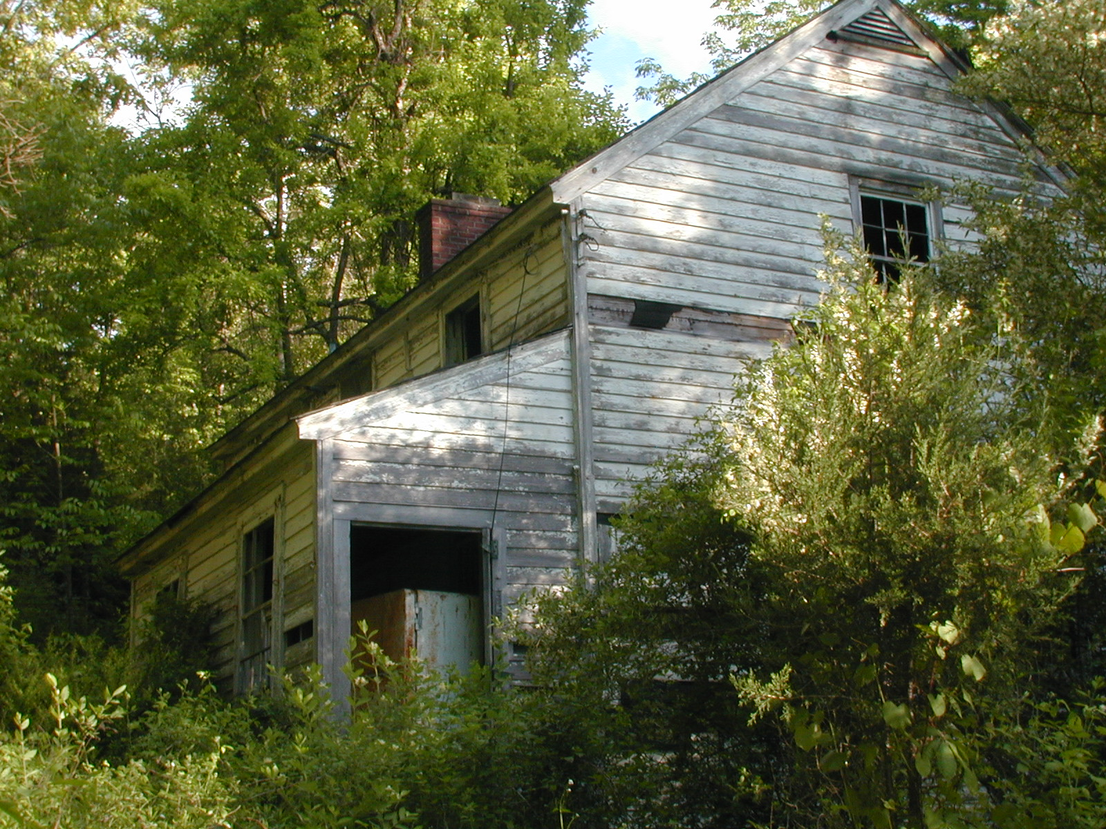 A rear quarter view of the second house