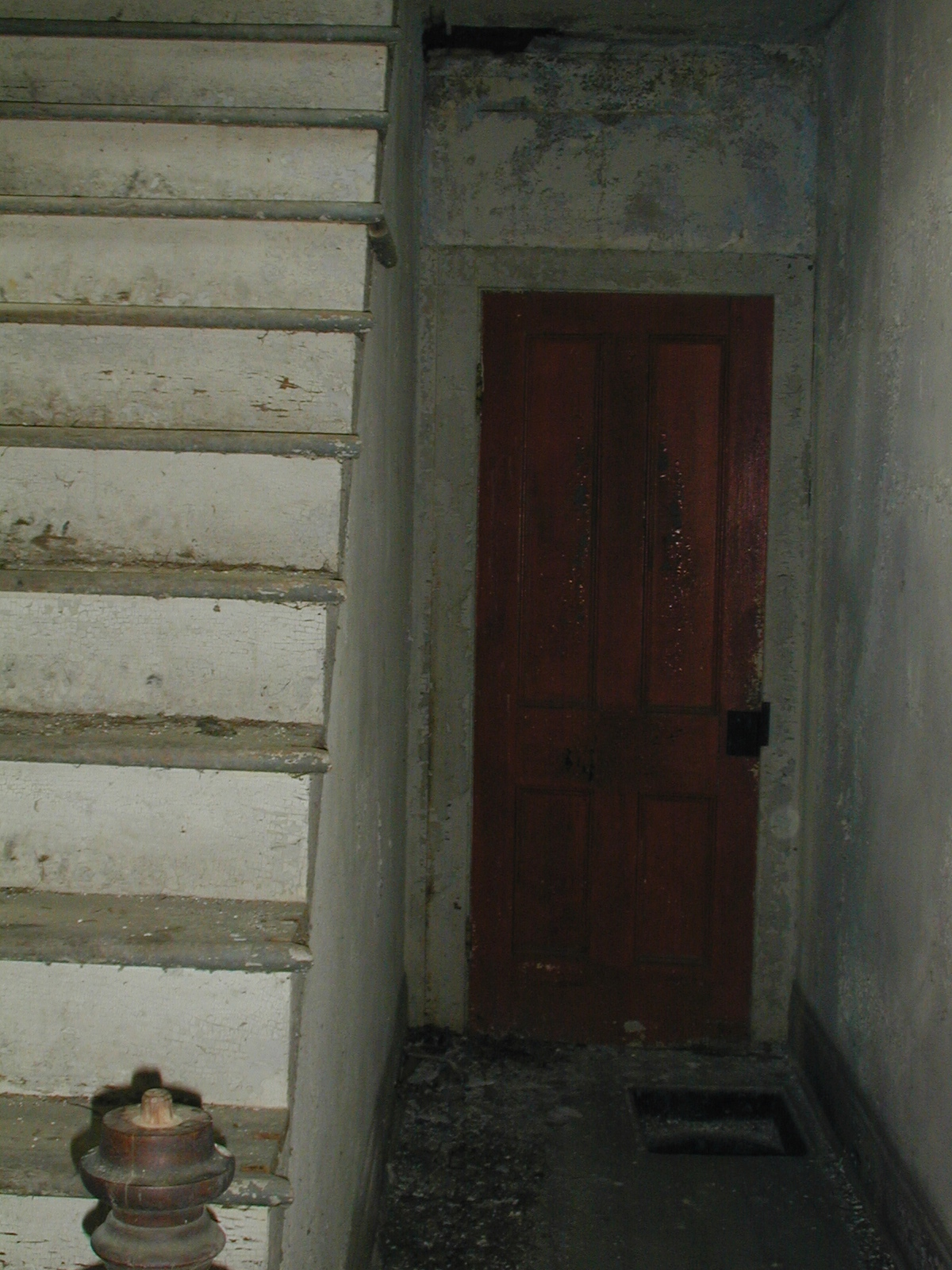 Narrow door by the stairs
