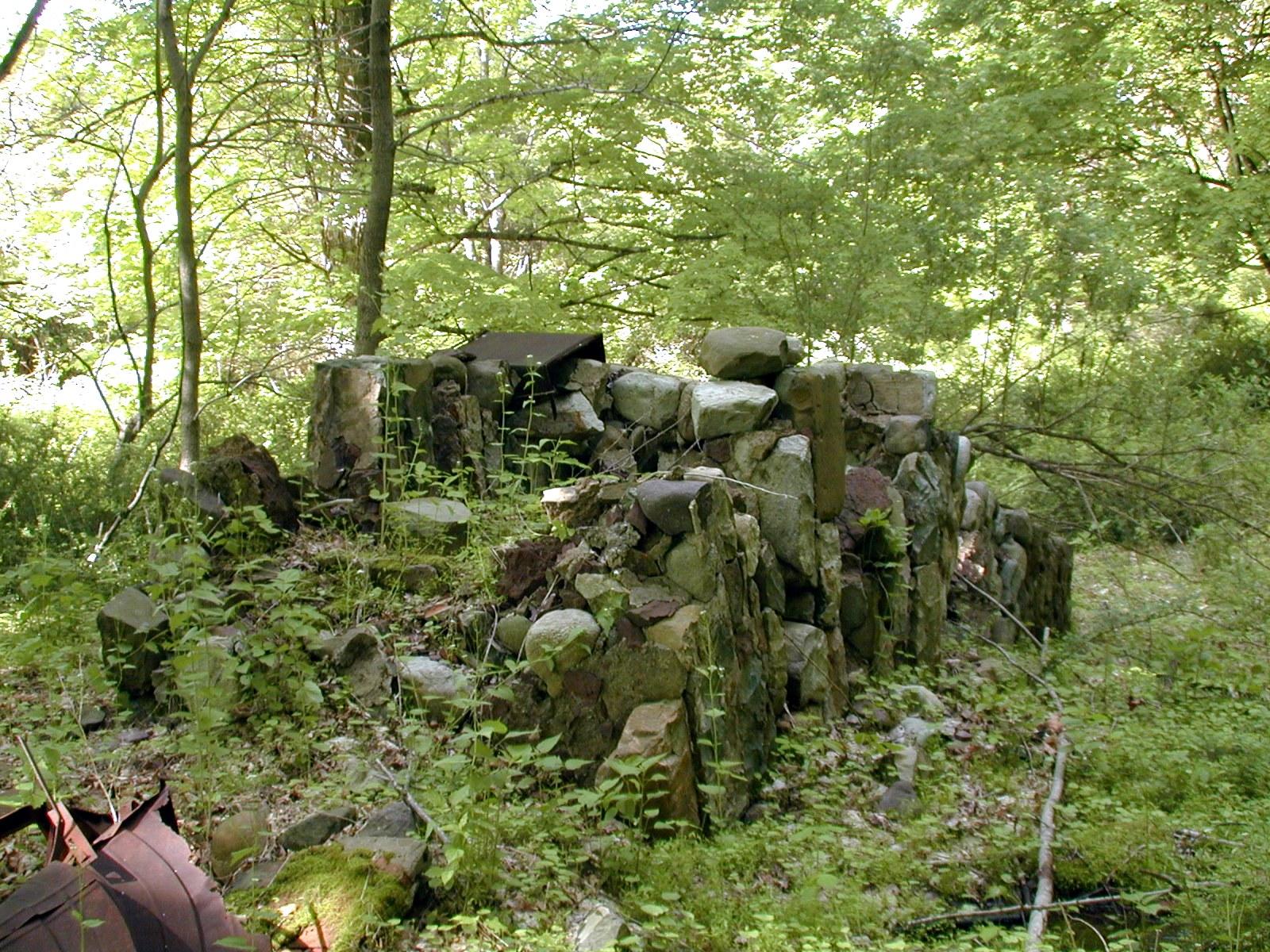Toppled chimney near the older Depue ruins